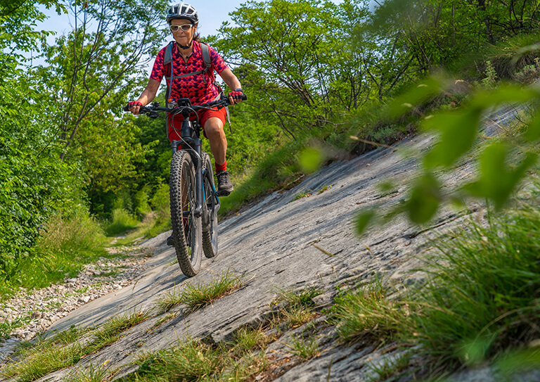Nice,,Active,Senior,Woman,Riding,Her,Electric,Mountain,Bike,In